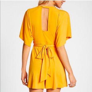 Express yellow open back tie waist romper- medium